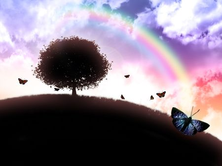 rainbow sky: silhouette of a tree against a background of iridescent sky