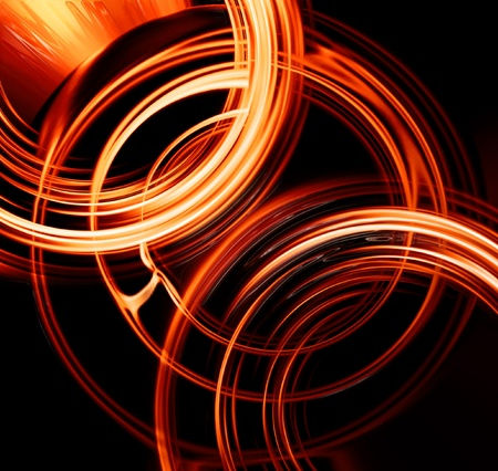 Abstract fiery circles on a dark background photo