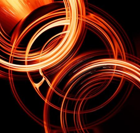 dynamic movement: C�rculos ardientes abstractas sobre un fondo oscuro Foto de archivo