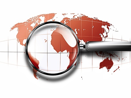 travel locations: magnifying glass on red abstract world map