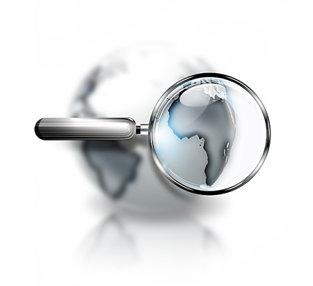 geographical locations: magnifying glass with blurred gray world