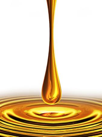 goccia di olio cade su uno sfondo bianco