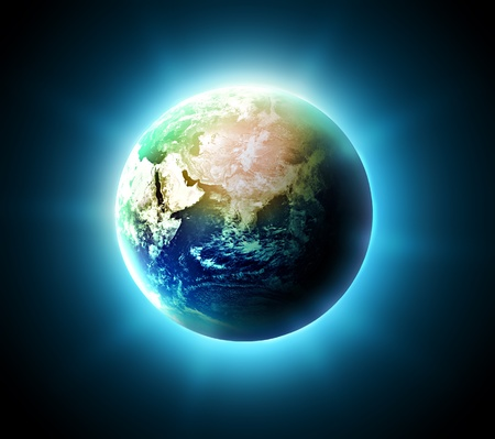 blue shining world on a dark background photo