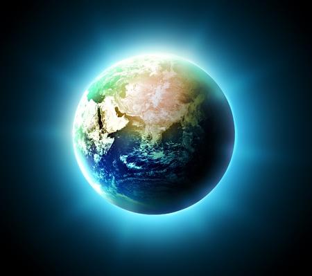 computer generated image: blue shining world on a dark background Stock Photo