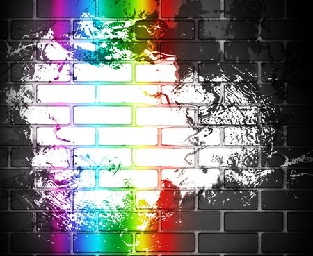 urban colors: grunge de fondo con pared de ladrillo negro con un arco iris Foto de archivo
