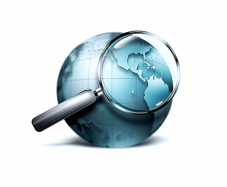 magnifying glass with blurred blue world Stock Photo - 12426261