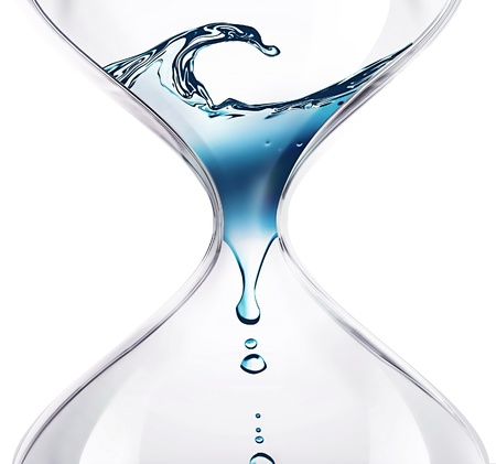 fresh water splash: hourglass with dripping water close-up