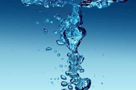 water splashing on a light background photo