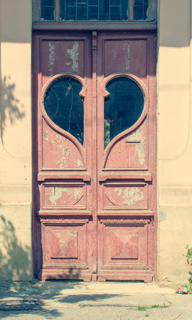 old vintage door with a window in shape of heart photo
