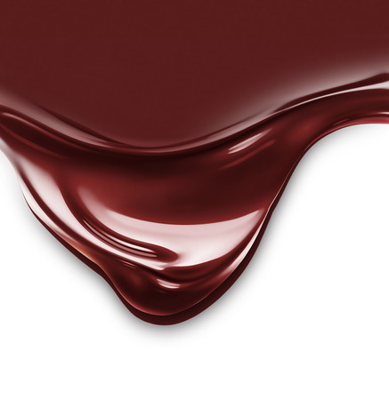 wave of liquid chocolate on white background
