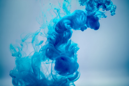 color: blue ink underwater as abstract background for your project