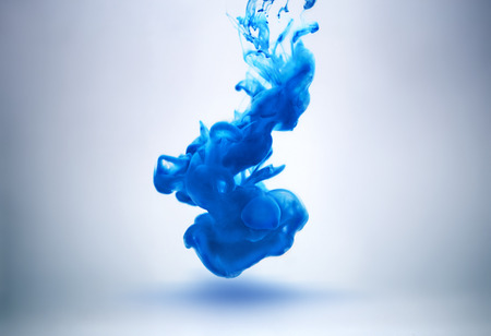 blue ink underwater as abstract background for your project