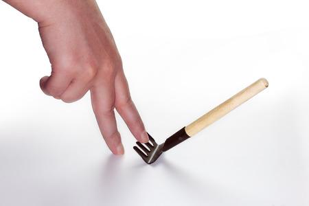 rake: step on rake concept image with a hand Stock Photo
