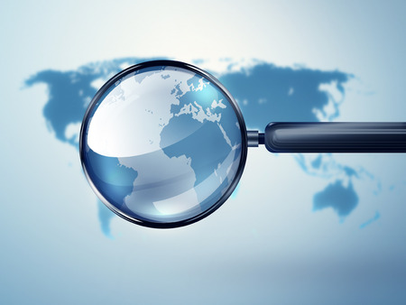 magnified: world map with magnifying glass - Conceptual image Stock Photo