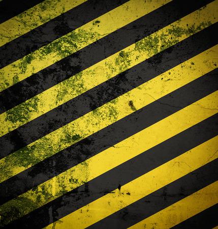 hazardous metals: grunge black and yellow surface as warning or danger background