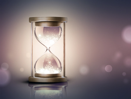hourglass with shining light on dark background with soft bokeh effect