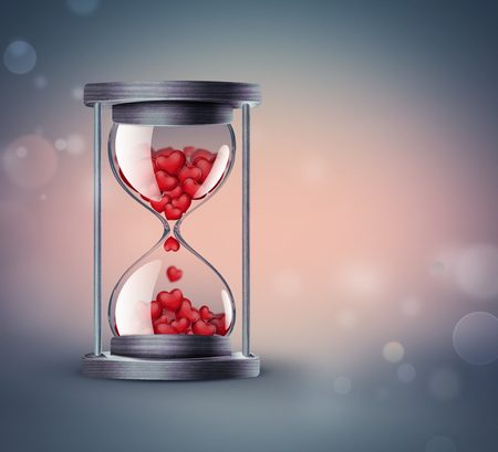 hourglass: hourglass with red hearts on background with soft bokeh effect