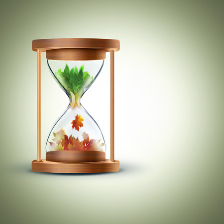 changing seasons: From summer to autumn.The changing seasons concept with hourglass Stock Photo