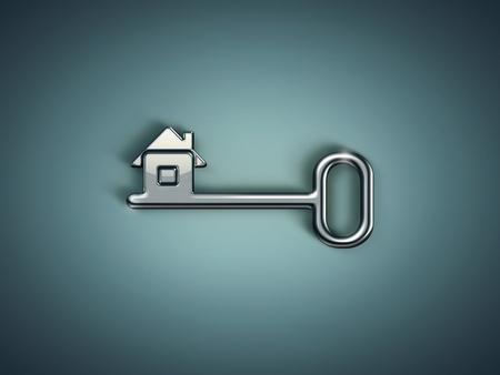 緑の背景の抽象的な家と金属製のキー 写真素材