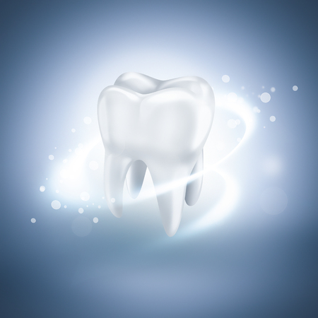 tooth whitening: shining white tooth on light blue background Stock Photo