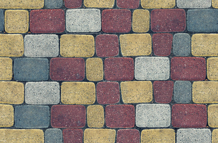 stone wall: seamless texture colored brick wall. Red, gray and yellow tones.