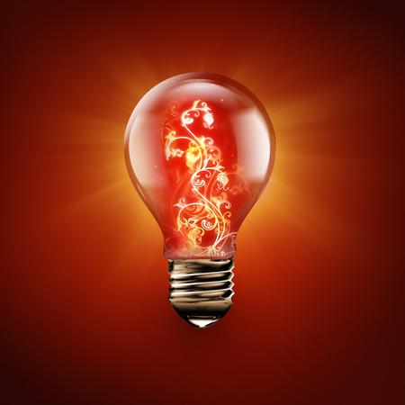 fire flower: light bulb with fire flower inside on red Stock Photo