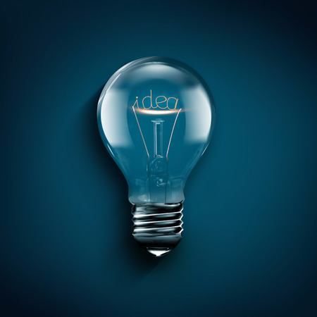 creativity symbol: conceptual image of idea with a light bulb on blue background Stock Photo