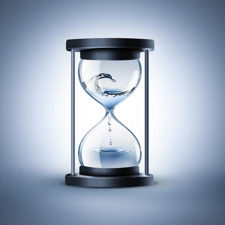 klepsydra z kapiącą wodą - czas płynie koncepcję