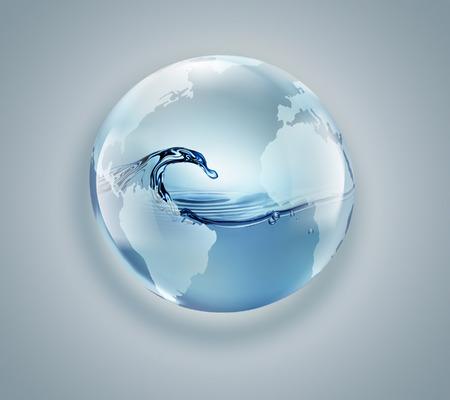 明るい背景の中のきれいな水と地球儀 写真素材