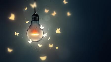 mariposas volando: bombilla luminosa y mariposas que vuelan en la luz