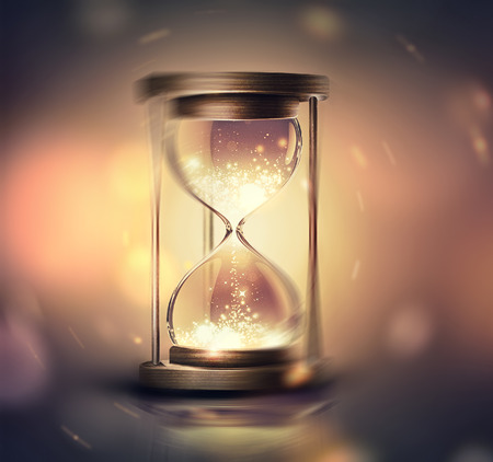 hourglass with shining light on dark background with soft bokeh effect, 3D image 免版税图像