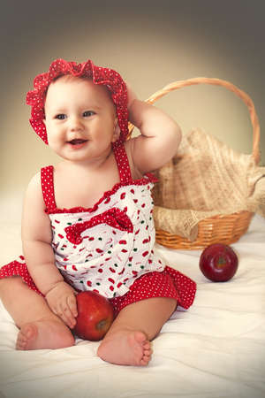 Little cute girl in red dress Foto de archivo
