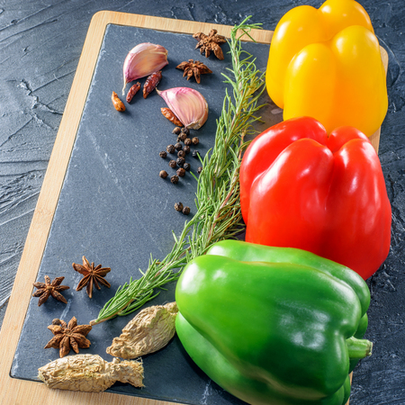 Vegetables and spices for cooking on the stale board. Reklamní fotografie