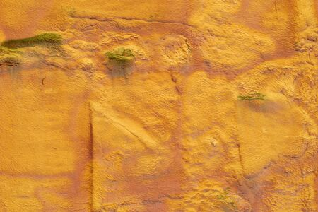 Textured orange wall covered with construction foam. Textured wall background.