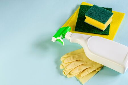Cleaning products for housekeeping, minimum set sloseup, top view. Domestic higiene.
