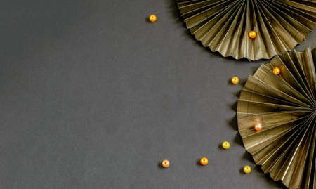 Nice decorative paper fans and beads on the black background. Beautiful design for your purposes.