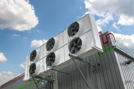 coolant temperature: Air conditioning system assembled on side of a building  Stock Photo