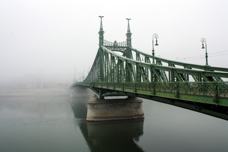 The iconic Liberty Bridge in Budapest in a typical autumnal foggy day