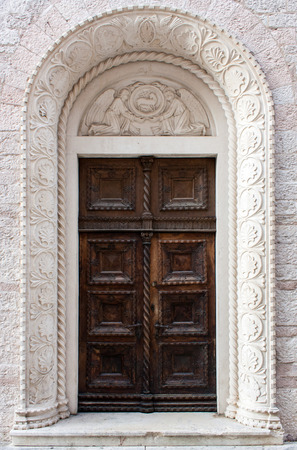 Brown door on a  stone building