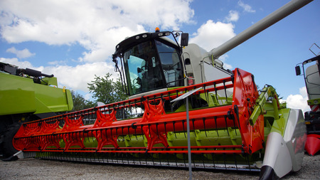 Combined harvester. Agriculture harvest machine against blue skye