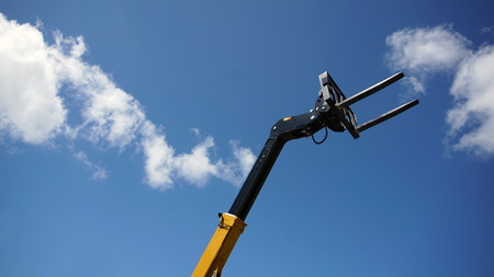 Forklift's head against blue sky