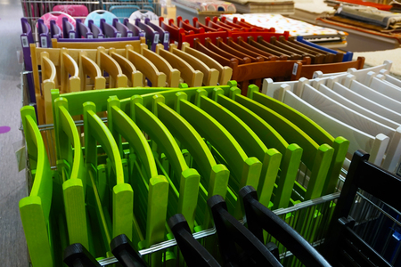 Colored folding textured chairs in store