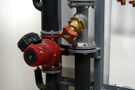 Red Circulation Pump and a balancing valve on the White Background Banque d'images