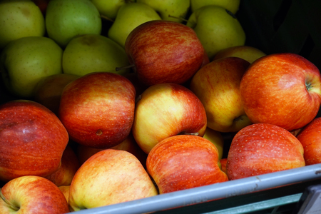Many apples on the store counter, fruit vitamins