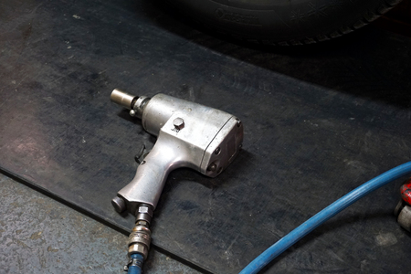 Air impact wrench on the floor.