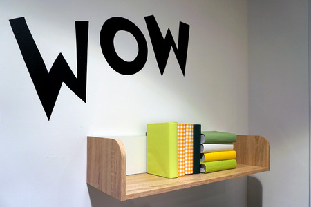 Book shelf decorate the living room on the white wall in living room. Wow sign Banque d'images