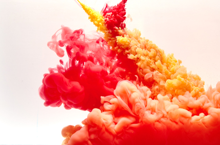 clouds making: Red and yellow inks making clouds in water