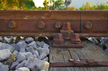 sleepers: High resolution rusty bolts and screws on abandoned railroad train track