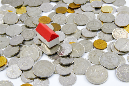 toy house: Toy house on coins Stock Photo