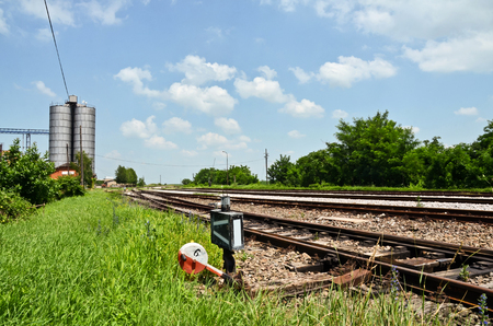 farmstead: Railway tracks and silos in Serbia Stock Photo